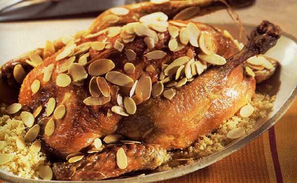 Poulet farci au couscous et aux amandes